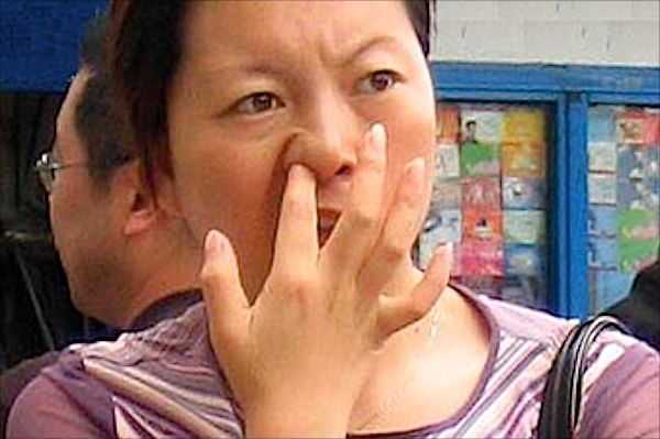 woman picking her nose